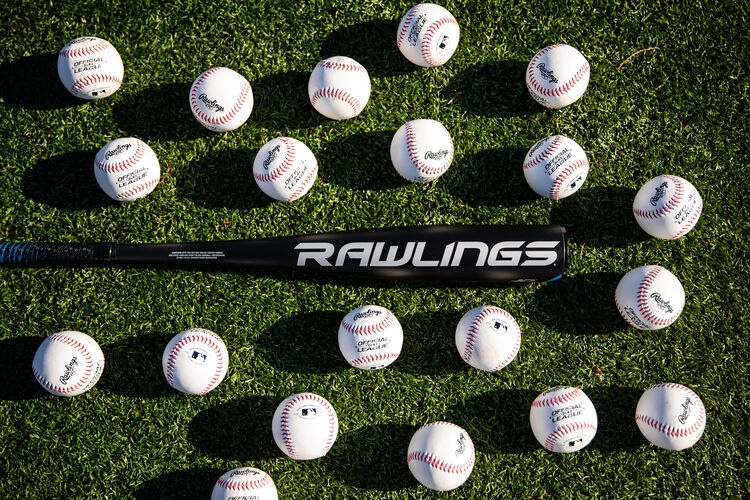 Rawlings logo on the barrel of a 5150 USA bat on a field surrounded by baseballs - SKU: US15