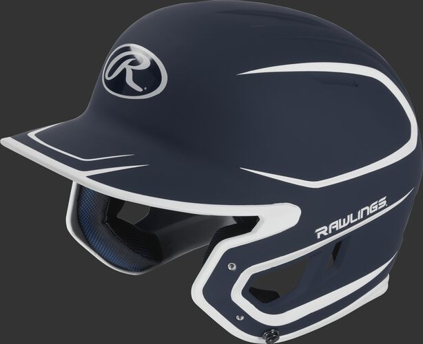Left angle view of a Rawlings MACH Junior helmet with a two-tone matte navy/white shell
