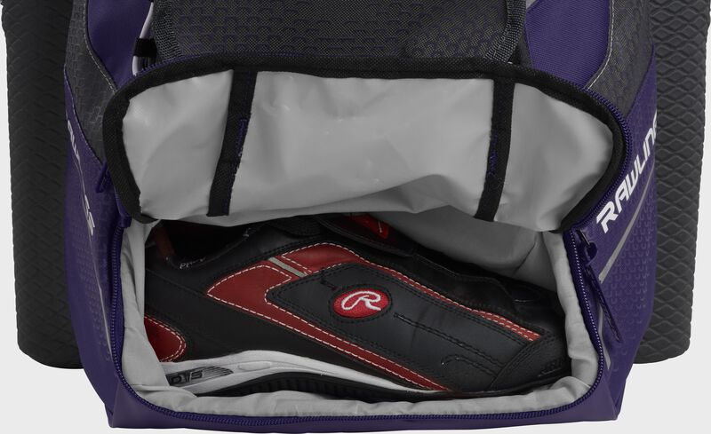 A purple Rawlings baseball backpack with a cleat in the bottom cleat storage compartment - SKU: IMPLSE-PU