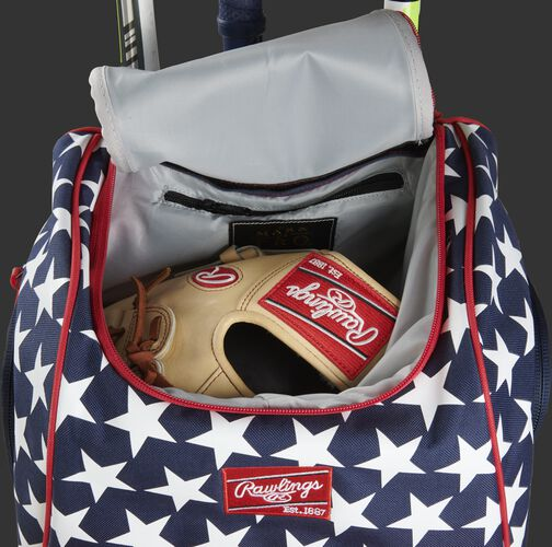 A glove in the dedicated glove storage pocket of a Rawlings Legion equipment backpack - SKU: LEGION-USA