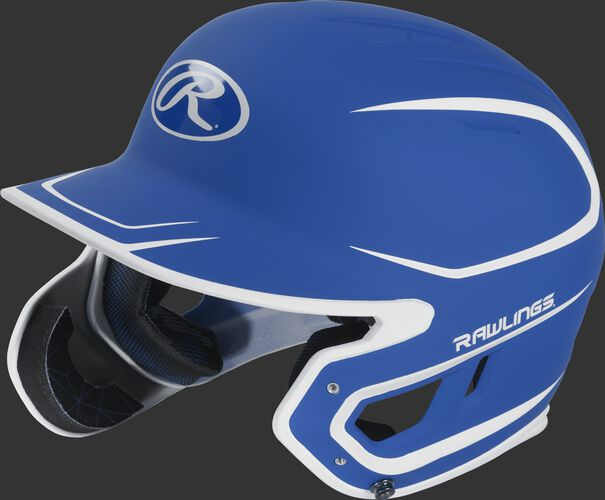 Left angle view of a MACHEXTR Rawlings Mach EXT Senior helmet with a two-tone matte royal/white shell