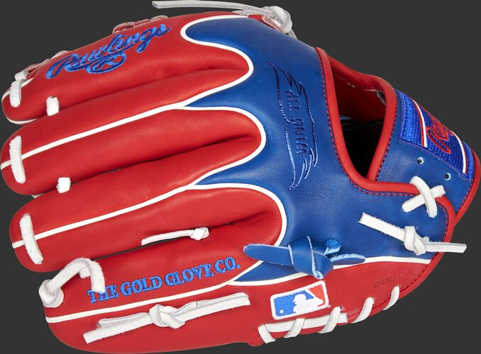 Scarlet/royal Wing Tip back of a Texas Rangers Heart of the Hide infield glove with the MLB logo on the pinky - SKU: RSGPRO204W-1TEX