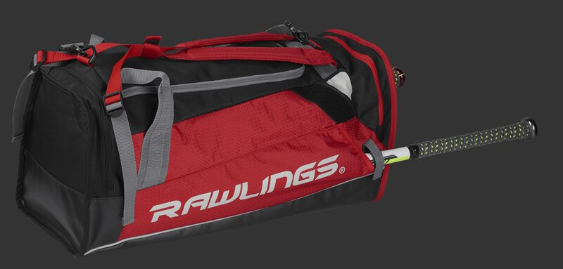 Side angle view of a scarlet R601 Rawlings Hybrid backpack/duffel bag with a bat in the side compartment