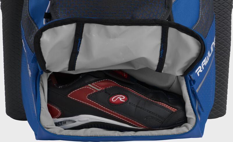 A royal Rawlings baseball backpack with a cleat in the bottom cleat storage compartment - SKU: IMPSLE-R