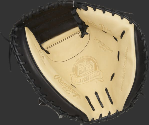 Camel palm of a Rawlings J.T. Realmuto catcher's mitt with black laces - SKU: PROSCM43JR10