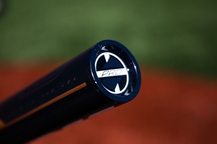 Navy end cap of a Quatro Pro -9 fastpitch bat with a field in the background - SKU: FPZP9