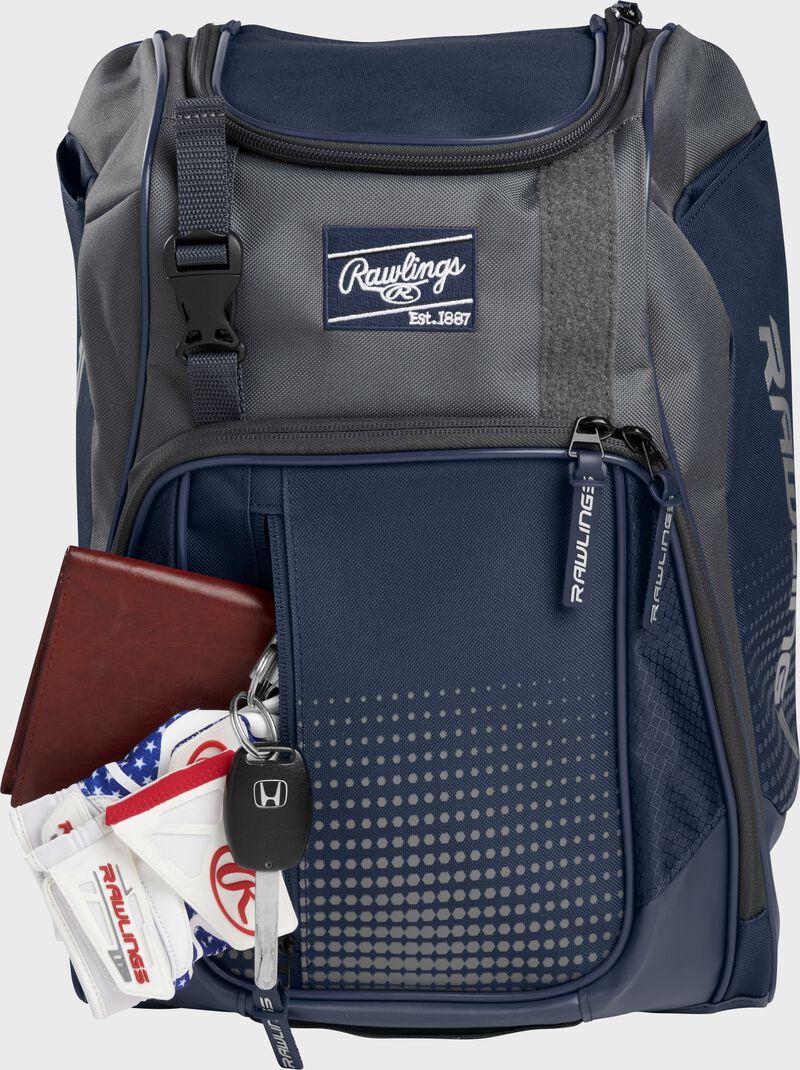 Wallet, keys, and batting gloves in the front valuables pocket of a navy Franchise baseball bag - SKU: FRANBP-N