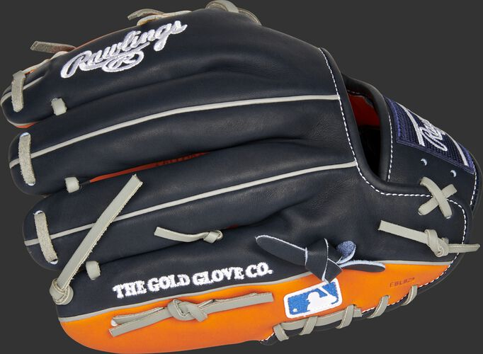 Back of a navy/orange Houston Astros Heart of the Hide infield glove with the MLB logo on the pinky - SKU: RSGPRO204-2HOU