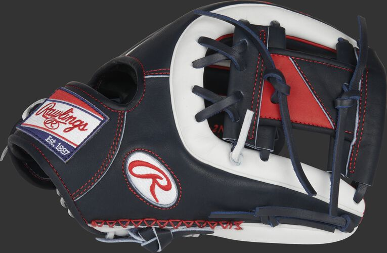 Thumb of a navy/white Heart of the Hide ColorSync 5.0 11.5-Inch infield glove with a navy/scarlet I-web - SKU: PRO314-2NW