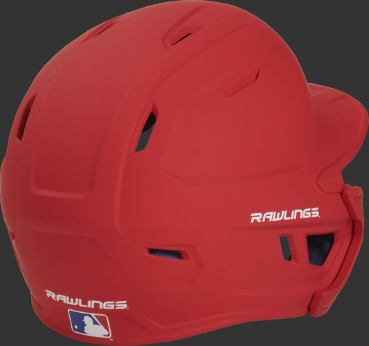 Back right of a matte scarlet MACHEXTL Rawlings junior size batting helmet