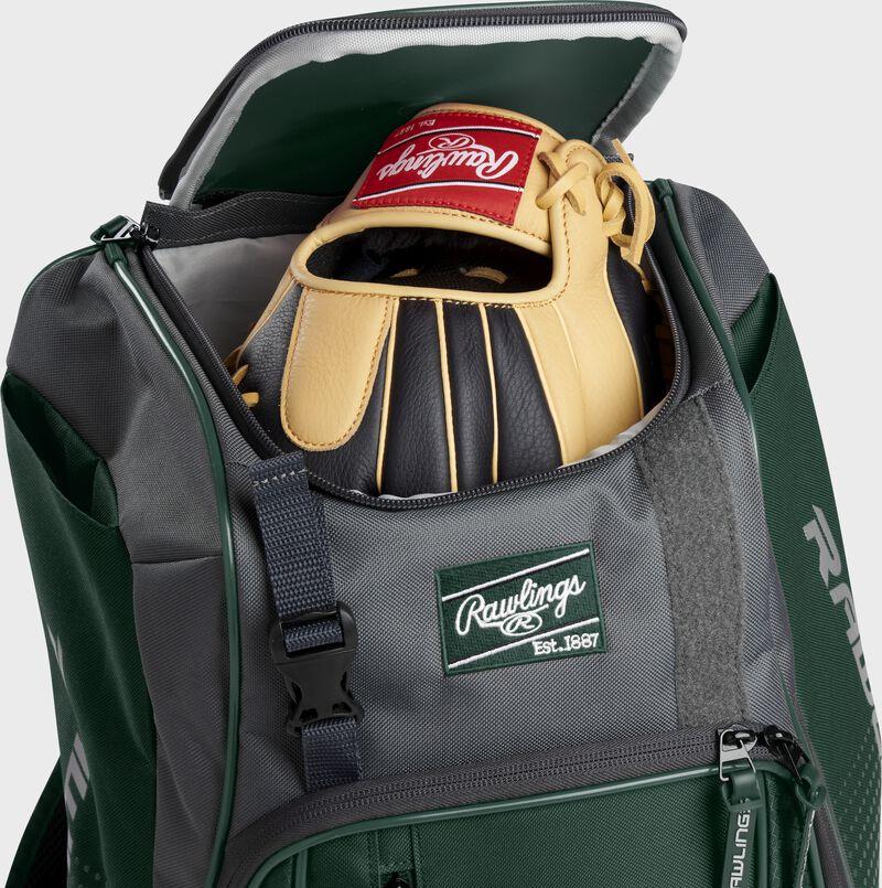 A Rawlings baseball glove in the top compartment of a Franchise baseball backpack - SKU: FRANBP-DG