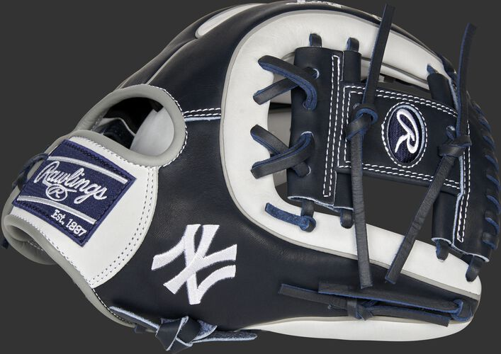Thumb of a navy/white 2021 New York Yankees Heart of the Hide glove with the Yankees logo on the thumb - SKU: RSGPRO314-2NYY