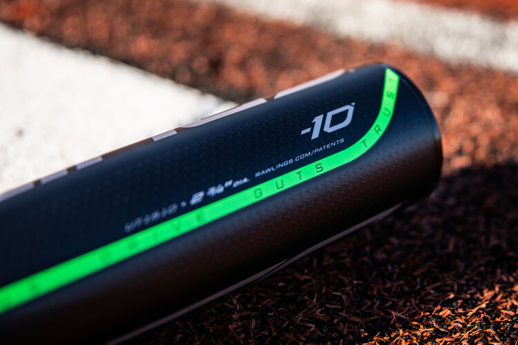 Barrel of a -10 5150 USSSA bat laying next to home plate on a field - SKU: UT1510