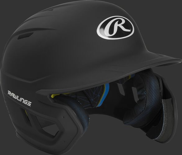 Right angle view of a MACHEXTR Rawlings Mach EXT junior helmet with a one-tone matte black shell