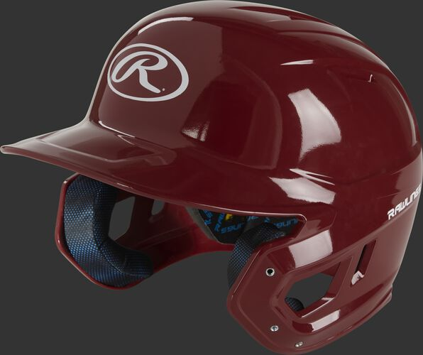 Left angle of a cardinal red MCH01A Mach high school batting helmet