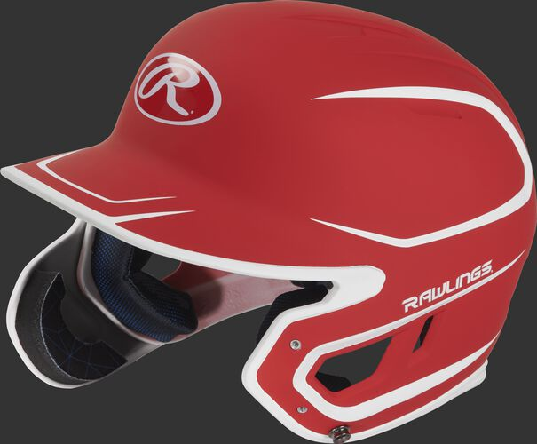 Left angle view of a MACHEXTR Rawlings Mach EXT Junior helmet with a two-tone matte scarlet/white shell