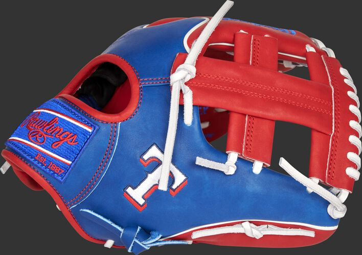 Thumb of a royal/scarlet 2021 Texas Rangers Heart of the Hide glove with the Rangers logo on the thumb - SKU: RSGPRO204W-1TEX