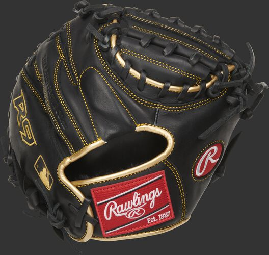 Back of a black 27-inch R9 Series training mitt with gold binding and a red Rawlings patch - SKU: R9TRCM