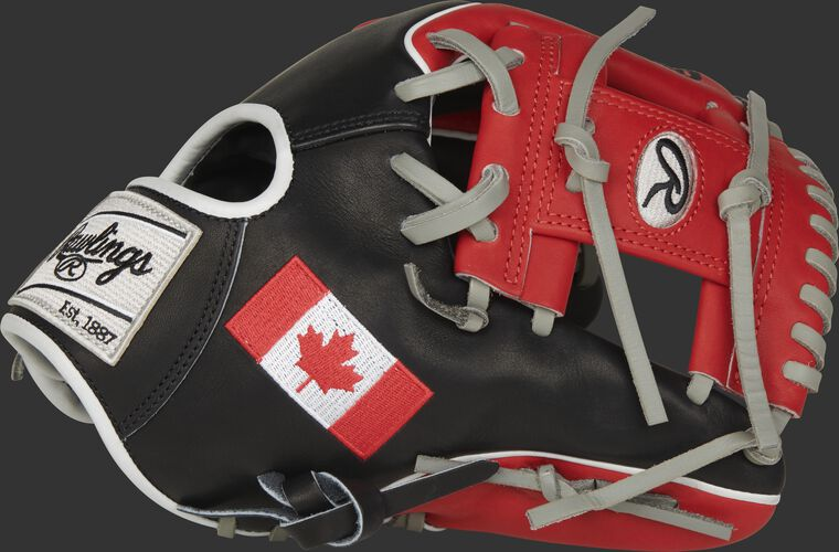 A black/scarlet PRO204W-2CA Heart of the Hide Canada infield glove with a scarlet I-web and Canadian flag on the thumb