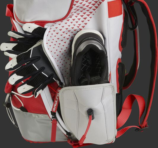 R800 fastpitch equipment backpack with a shoe and batting gloves in the side storage compartments