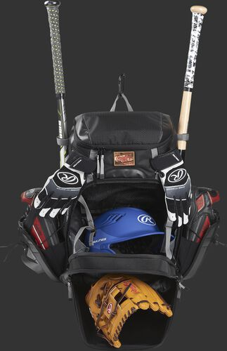 A black R1000 Rawlings Gold Glove bag with the main compartments open and filled with a helmet, glove, bats and cleats