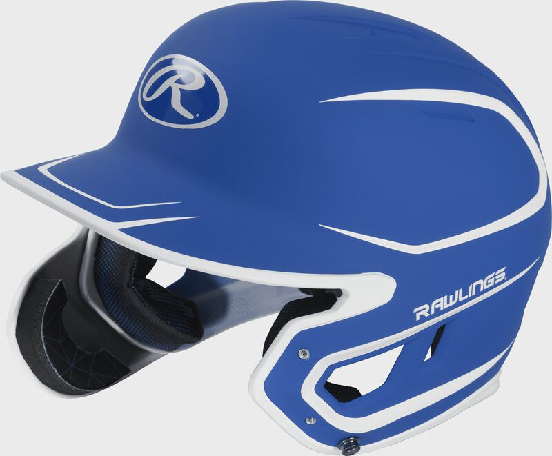 Left angle view of a MACHEXTR Rawlings Mach EXT Junior helmet with a two-tone matte royal/white shell