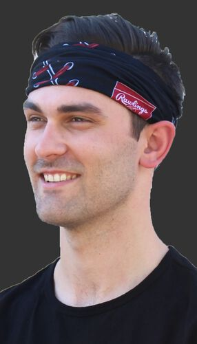 A guy wearing a black stitch multi-functional neck gaiter as a head band - SKU: RC40001-001