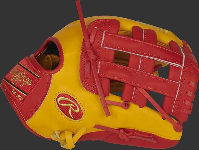 Thumb of a gold tan/scarlet PRO206-6GTS Heart of the Hide 12-Inch infield glove with a scarlet H-web