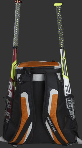 Back of a black/orange R500 team backpack with two bats in the side sleeves
