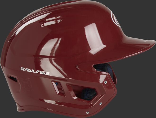 Right side ear flap of a MCH01A Rawlings Mach baseball batting helmet with a cardinal red shell