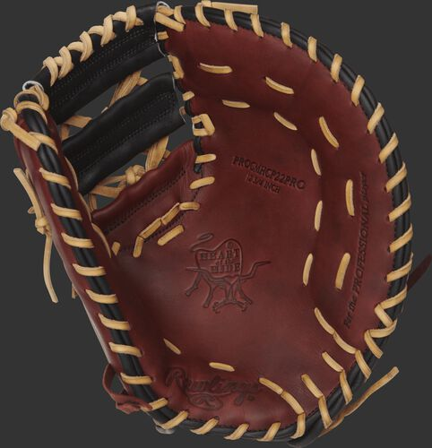 Burgundy palm of a Rawlings HOH first base mitt with a black web and camel laces - SKU: PROCMHCP22PRO