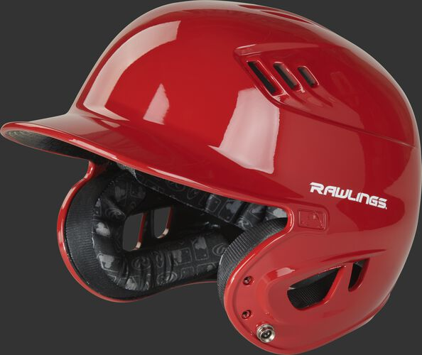 Left angle view of a R1601 gloss Velo helmet with a scarlet clear coat shell