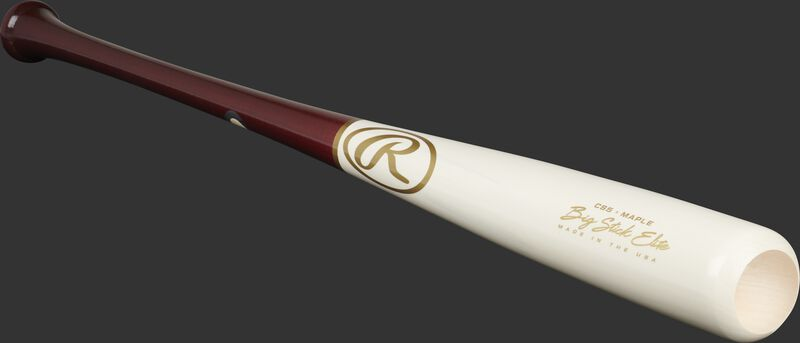 Angled view of a white wash/wine red Big Stick Elite Maple bat with a cupped end - SKU: CS5RMW