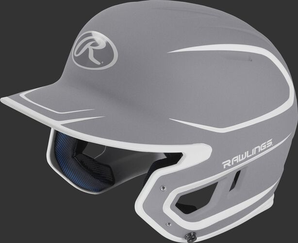 Left angle view of a Rawlings MACH Junior helmet with a two-tone matte silver/white shell