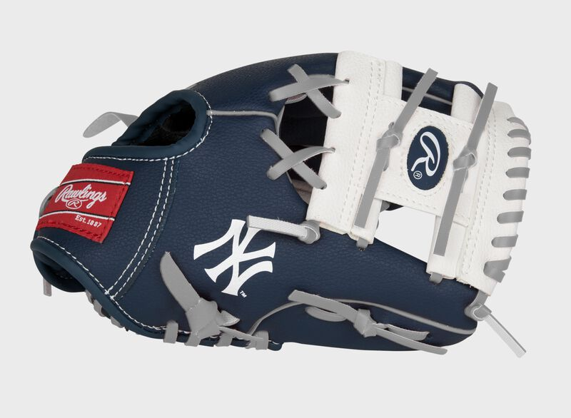 """A navy, white & red New York Yankees 10-inch team logo glove with a white I-web and """"NY"""" logo on the thumb - SKU: 22000030111"""