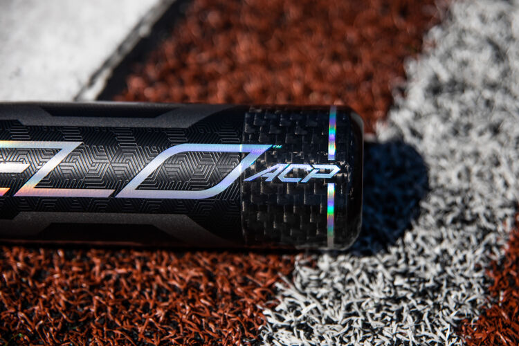 Velo ACP end cap on a USA bat lying next to home plate - SKU: USZV10