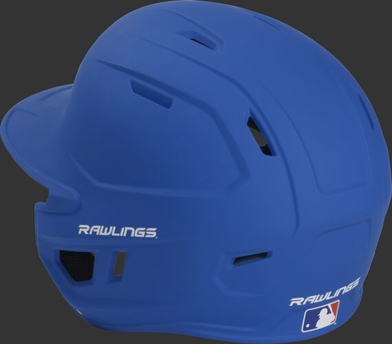 Back left view of a matte royal MACHEXTL MACH series batting helmet with air vents