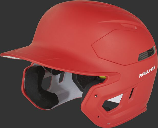 Left angle view of a matte scarlet CAR07A MACH Carbon high school/college batting helmet