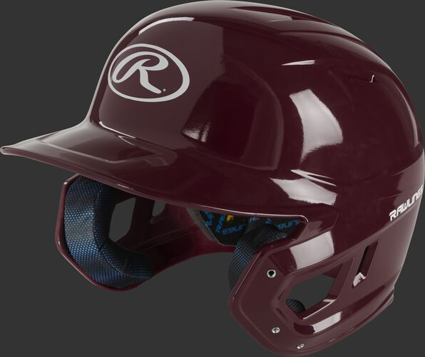 Front left of a maroon MCH01A Mach high school batting helmet