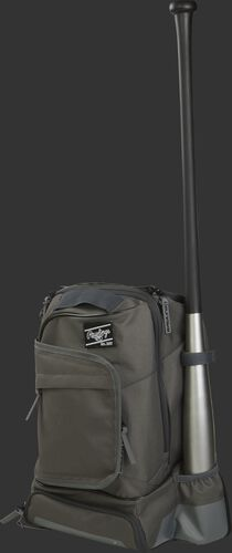 Left angle of a grey R701 baseball training backpack with one bat