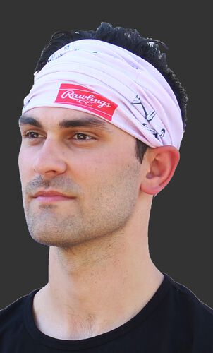 A guy wearing a pink stitch multi-functional neck gaiter as a head band - SKU: RC40001-681