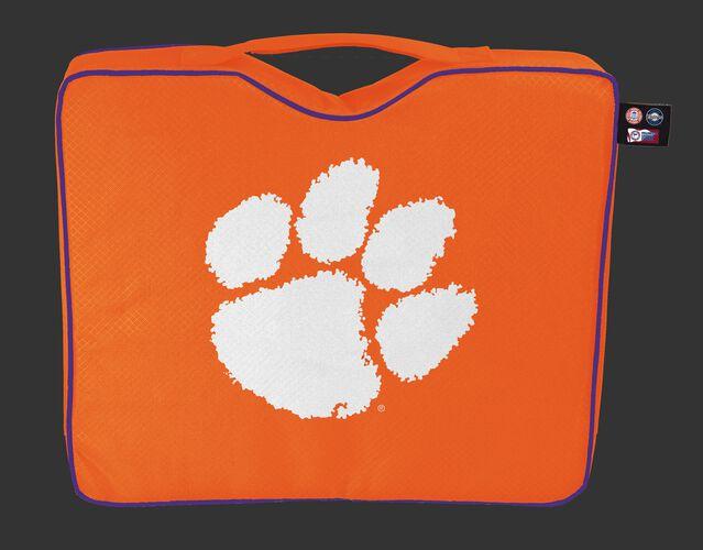 An orange NCAA Clemson Tigers bleacher cushion with a white team logo printed on the top