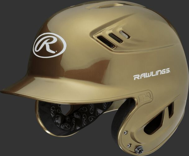 A metallic vegas gold R16S Velo senior batting helmet with Cool-Flo vents