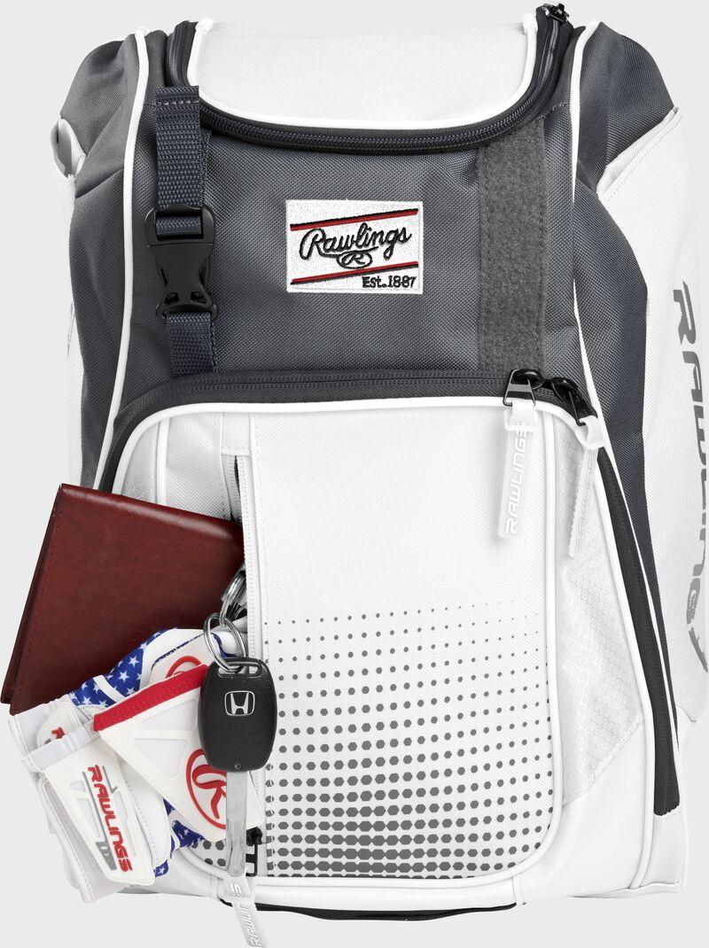 A Rawlings baseball glove in the top compartment of a Franchise baseball backpack - SKU: FRANBP-W