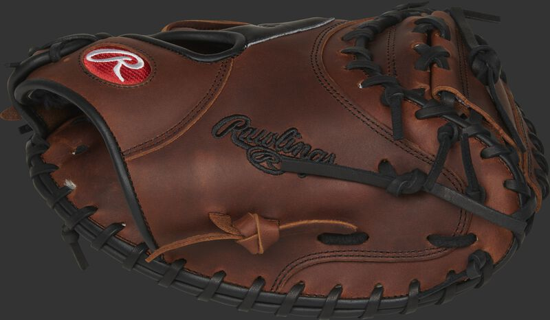 Thumb view of a timberglaze PROSCM20JTXRDP Heart of the Hide 32.5-Inch catcher's mitt with a 1-piece solid web