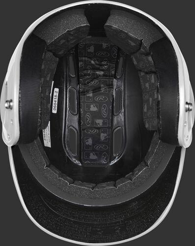 Inside of a white R1601 Velo batting helmet with black foam padding