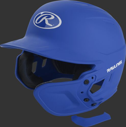 A royal MEXTR attached to a Mach batting helmet with the removable TPU piece off to show the hardware