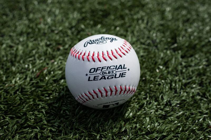 A Rawlings Official League recreational ball lying on a field - SKU: OLB3