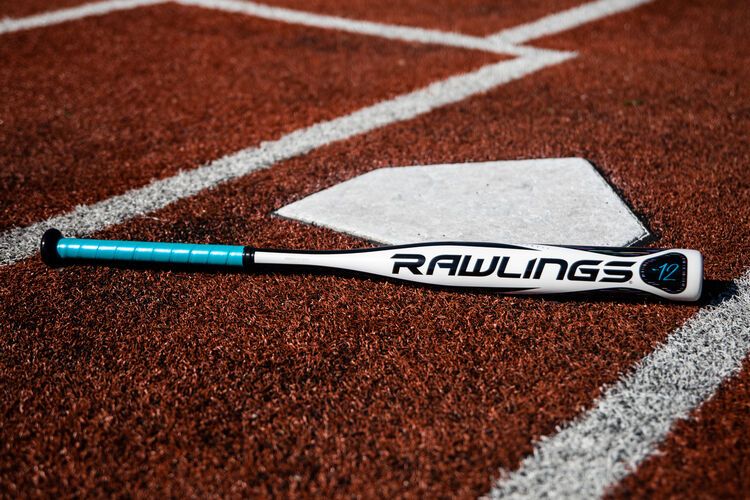 A Rawlings 2020 Eclipse bat lying next to home plate - SKU: FPZE12