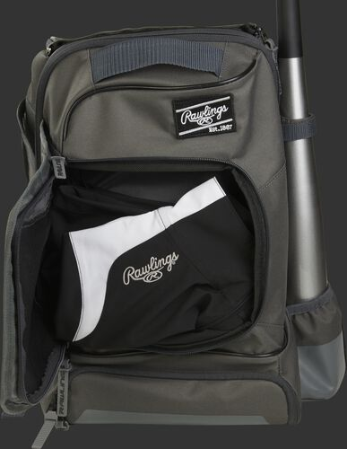 Locker style compartment of a grey R701 baseball training bag with a jacket in the pocket